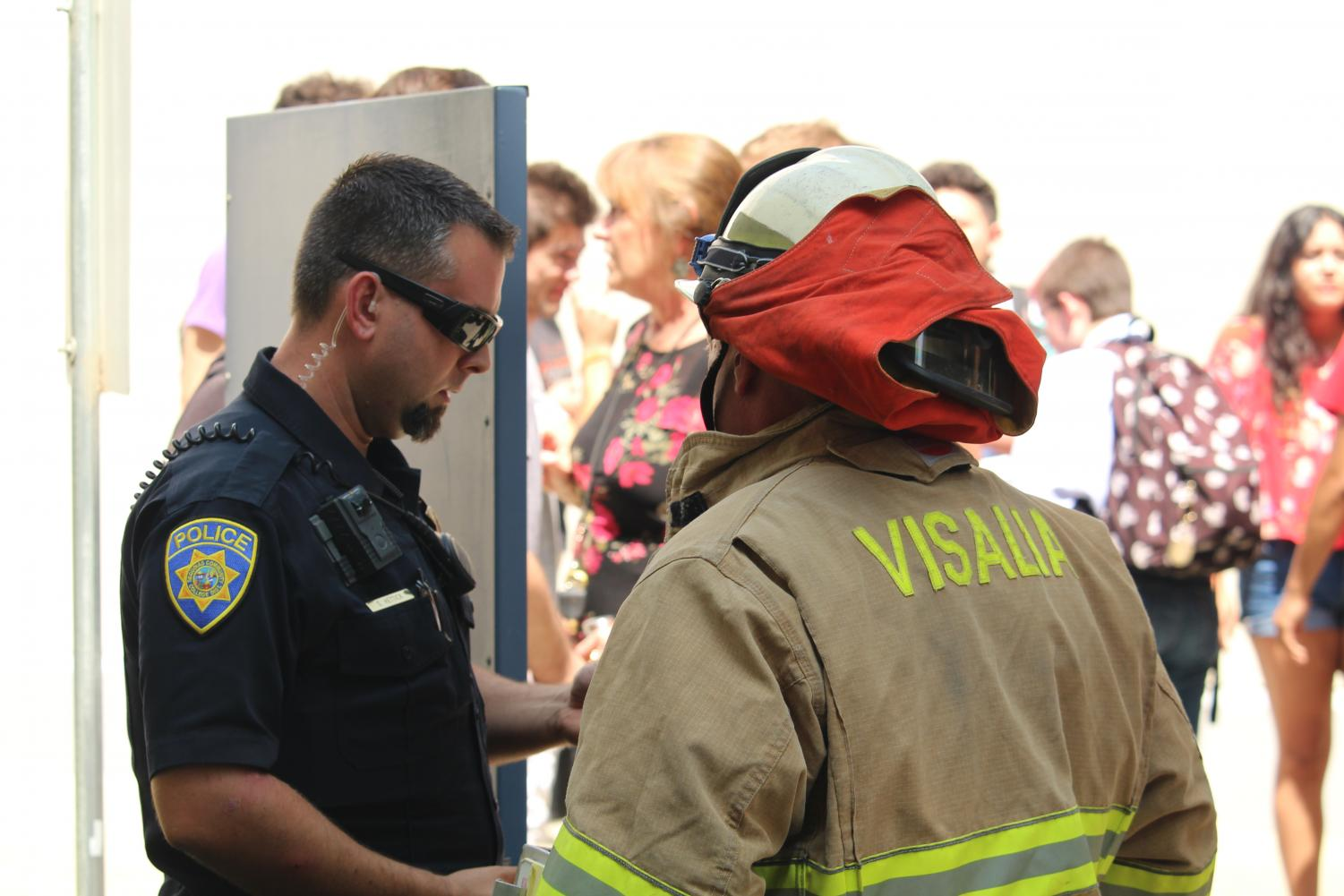COS district police office Duke Hettick meets with the Visalia Fire Department outside of the Sierra building.