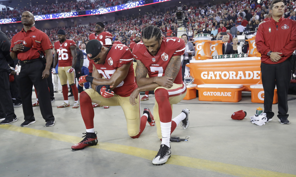 San Francisco 49ers safety Eric Reid (35) and quarterback Colin Kaepernick (7) kneel during the national anthem before an NFL football game against the Los Angeles Rams in Santa Clara, Calif., Monday, Sept. 12, 2016. (AP Photo/Marcio Jose Sanchez) ORG XMIT: FXN