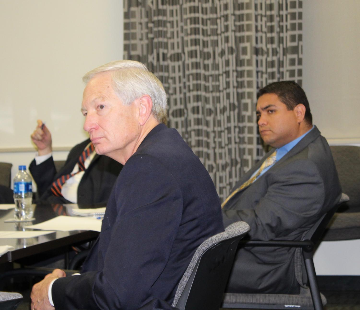 John Lehn (left) and Ray Macareno (right) sit in on a meeting.