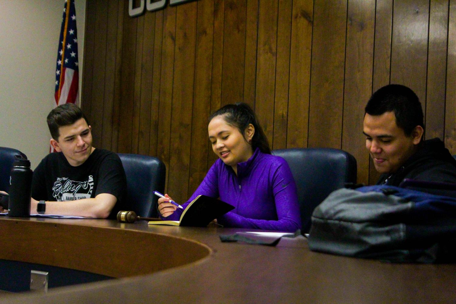 Kenneth O'Leary (left), Isabella O'Keeffe (center), Antonio Gutierrez (right) prepare to begin their meeting.