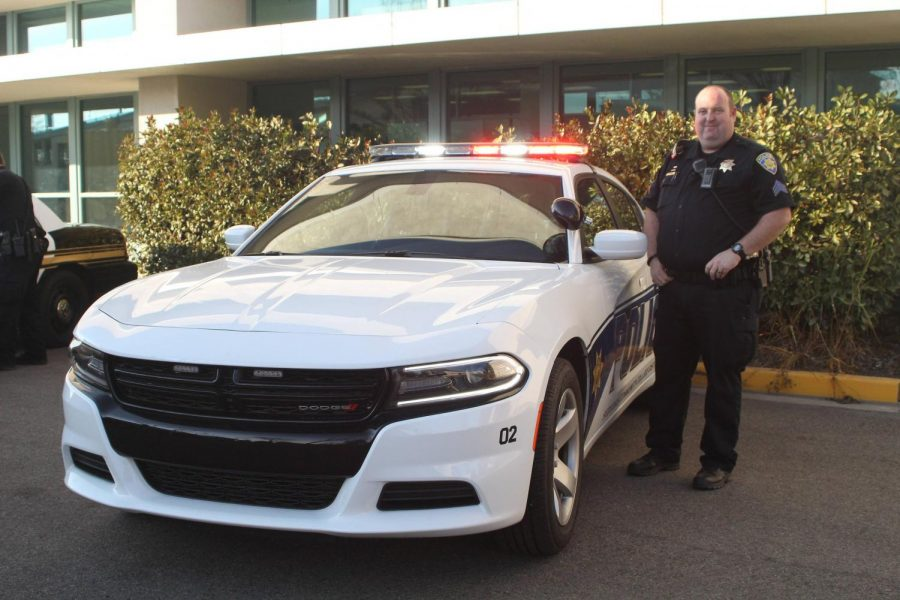 COS Police Sergeant Donald Charles stands next to his new Police Cruiser.