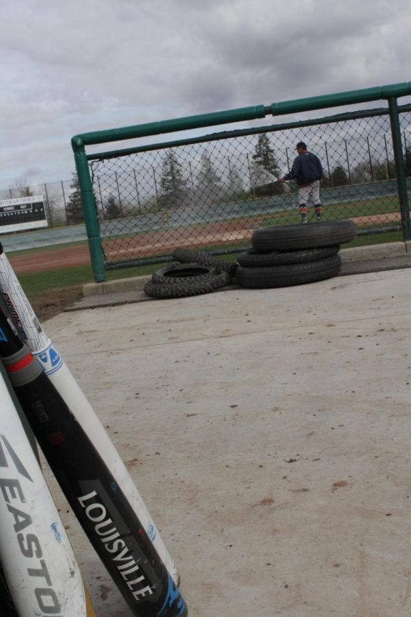 Baseball+wets+the+field+before+practice.