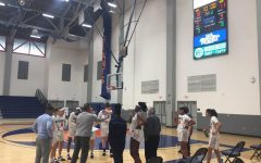 Ray Alvarado and womens basketball having a discussion about play call at the end of the First quarter against Antelope Valley