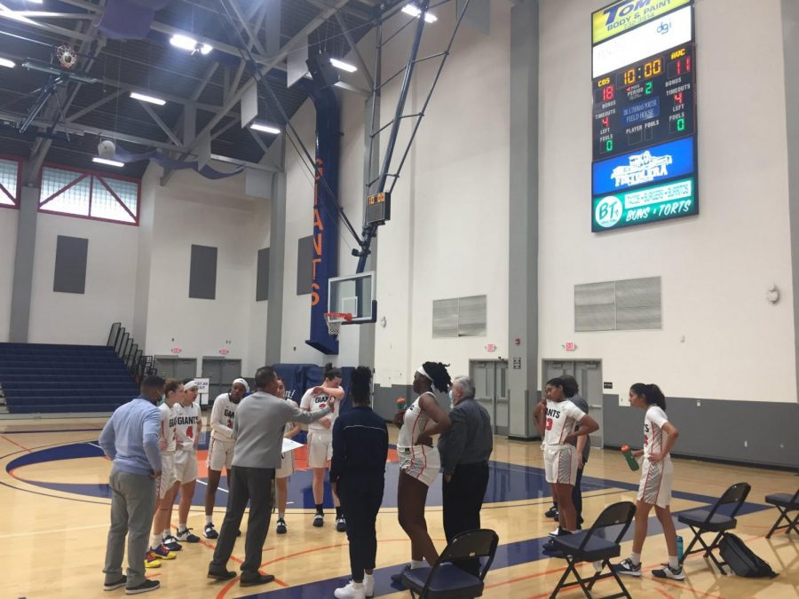 Ray Alvarado and women's basketball having a discussion about play call at the end of the First quarter against Antelope Valley
