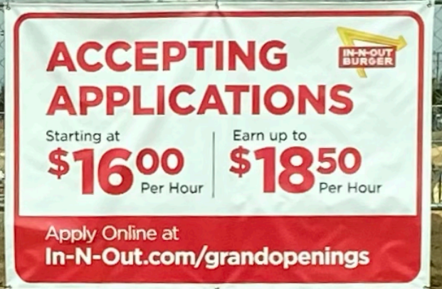 Hiring sign that sits posted outside the new location.
