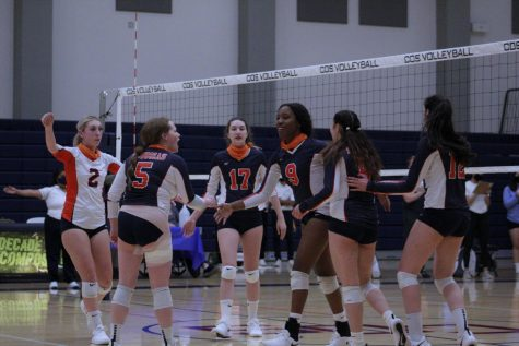 """The Lady Giants are celebrating after getting a """"kill"""" against Cerro Coso College"""