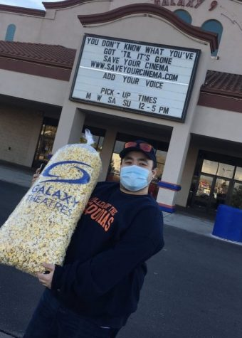 Campus writer, Jordan, outside of a local movie theatre set to open.
