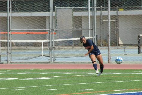 Captain Savanna Saesee whips in a cross from a free kick